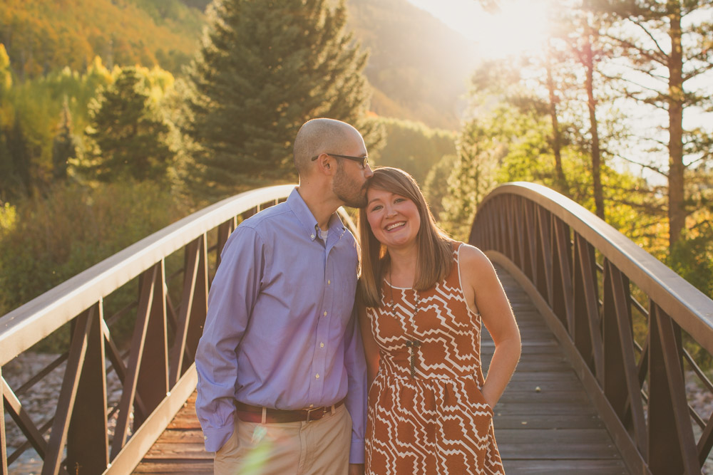 engagement-vail-colorado, vail-village-bridge-photograph, colorado-engagement-photographs, denver-wedding-photographer, colorado-wedding-photography, wedding-photography, engagement-photos, wedding-photographer-denver, holding-hands-under-bridge, famous bridge, vail-engagement, wedding-photographer-denver, beautiful-couple-colorado, real-honest-simple-photography, happy-engaged-couple-colorado