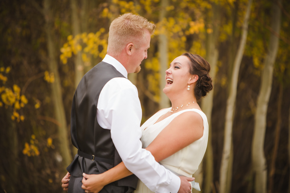 first-look-photos, bride-and-groom-first-look, fall-wedding-colorado, colorado-wedding-photographer, silverthorne-wedding-photos, silverthorne-pavillion, mountain-wedding-colorado, photojournalism, candid-photos, laughter