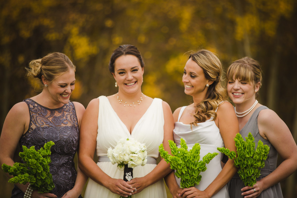 colorado-wedding-photography, silverthorne-pavillion, silverthorne-wedding-photographs, fall-mountain-wedding, denver-wedding-photographer, laughing-bride, bride-and-bridesmaids