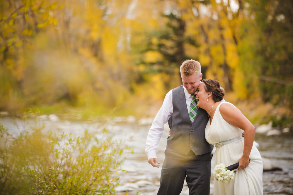 colorado-wedding-photography, silverthorne-pavillion, silverthorne-wedding-photographs, fall-mountain-wedding, denver-wedding-photographer, laughing-bride,  colorado-river-photograph