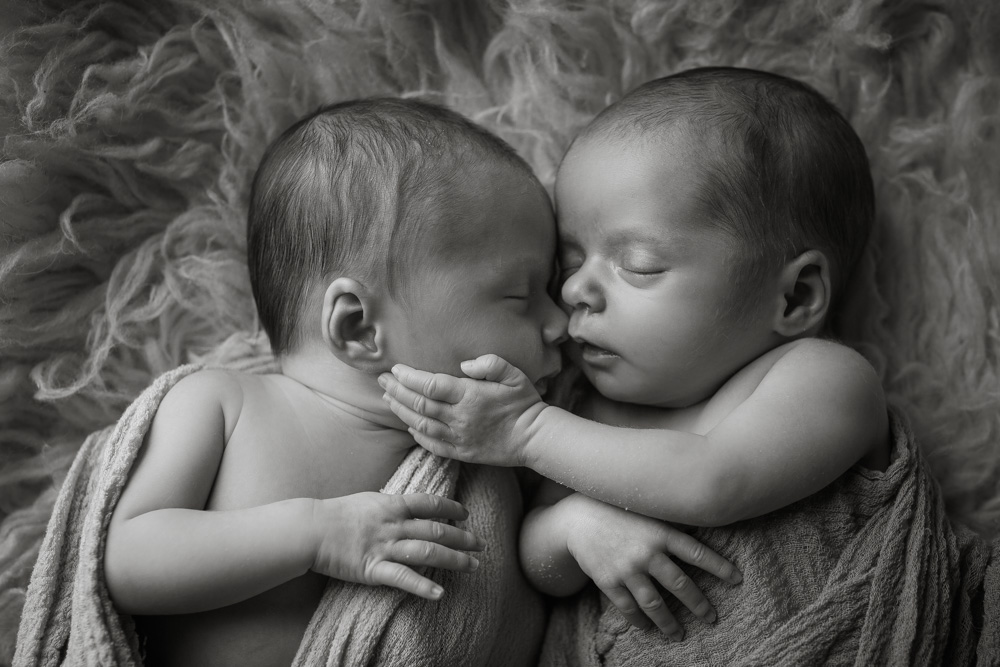 black-and-white-photos, baby-girl-touches-sisters-face, newborn-twins, photos-of-babies