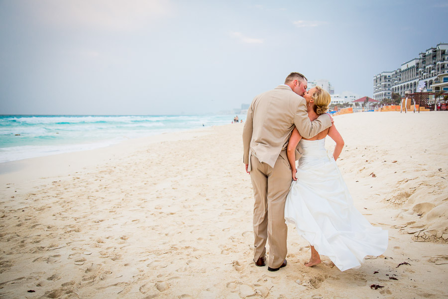 Mexico destination wedding bride and groom kissing on beach