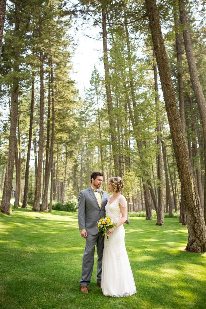 montana lake wedding bride and groom tall trees