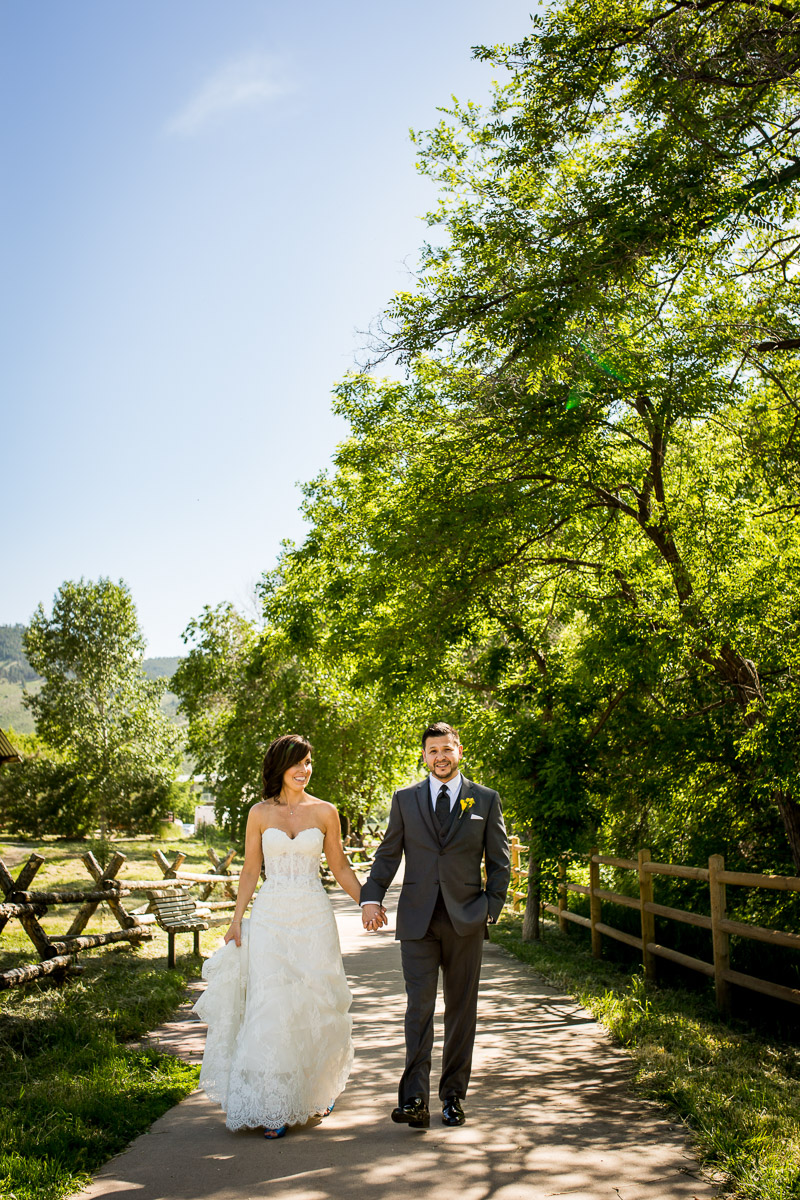 Golden Colorado wedding photo bride and groom candid laughing colorful photo