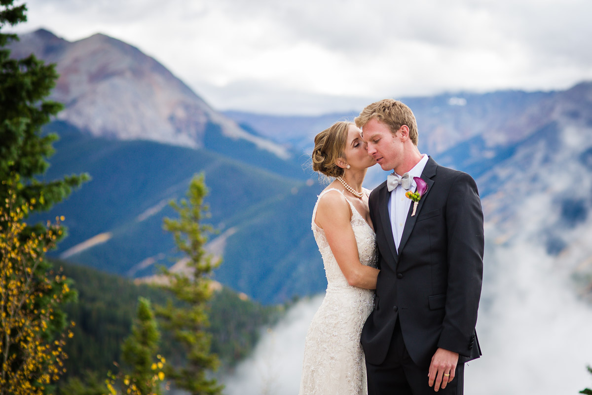 loving moment between bride and groom Aspen Colorado fall mountain wedding