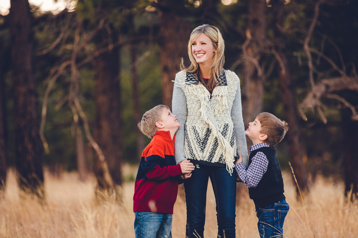 mom and sons laughing holding hands winter family photo session