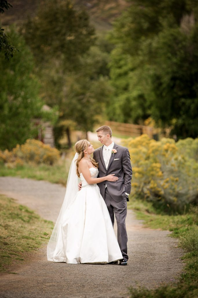 colorful fall wedding bride and groom smiling in love