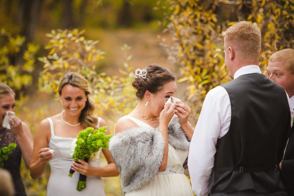 emotional bride wipes tears away fall ceremony Flagstaff Arizona