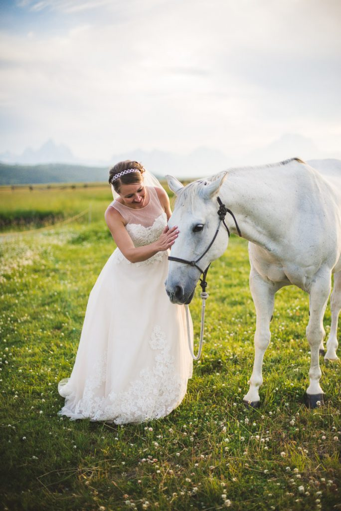 bride with white horse Grand Tetons Jackson Hole photograph
