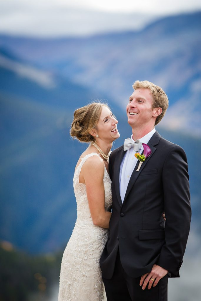 candid laughing bride and groom mountain wedding aspen colorado