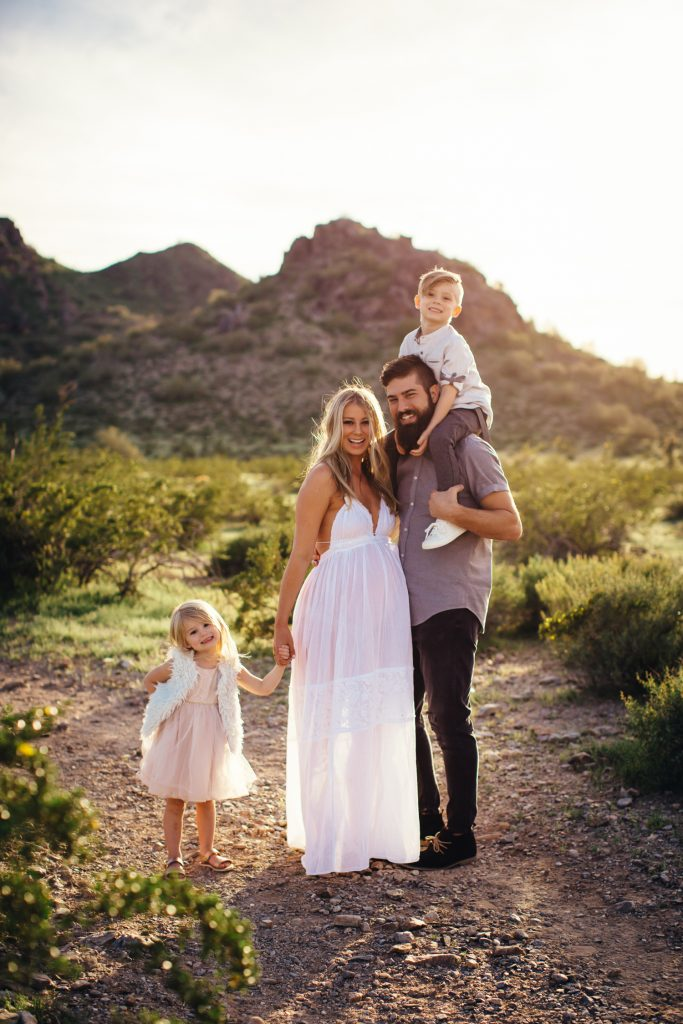 Family photographer with gorgeous family in Phoenix Mountain Preserve at sunset
