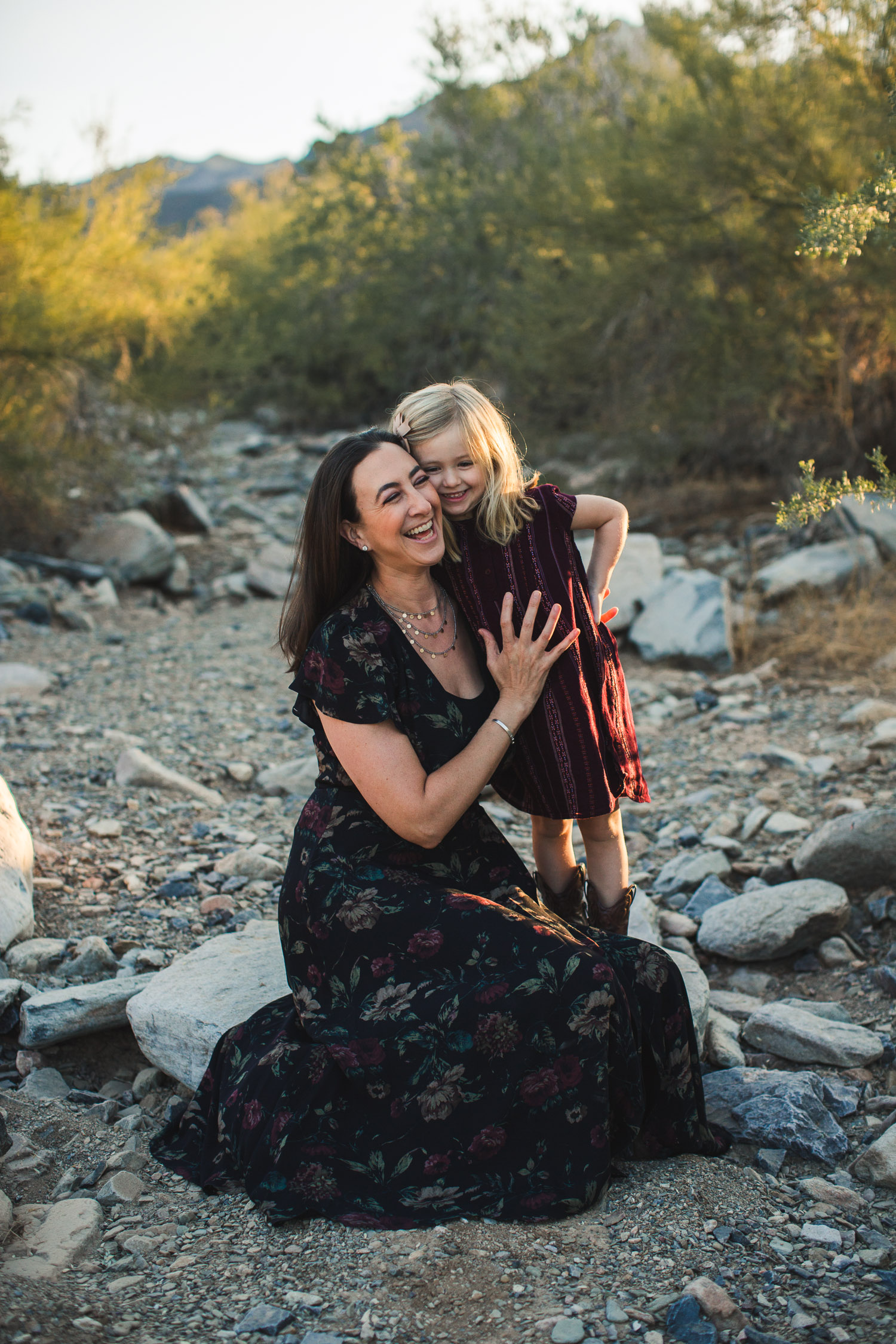 mom and daughter laughing beautiful candid moment desert rocks Phoenix Family Photograph