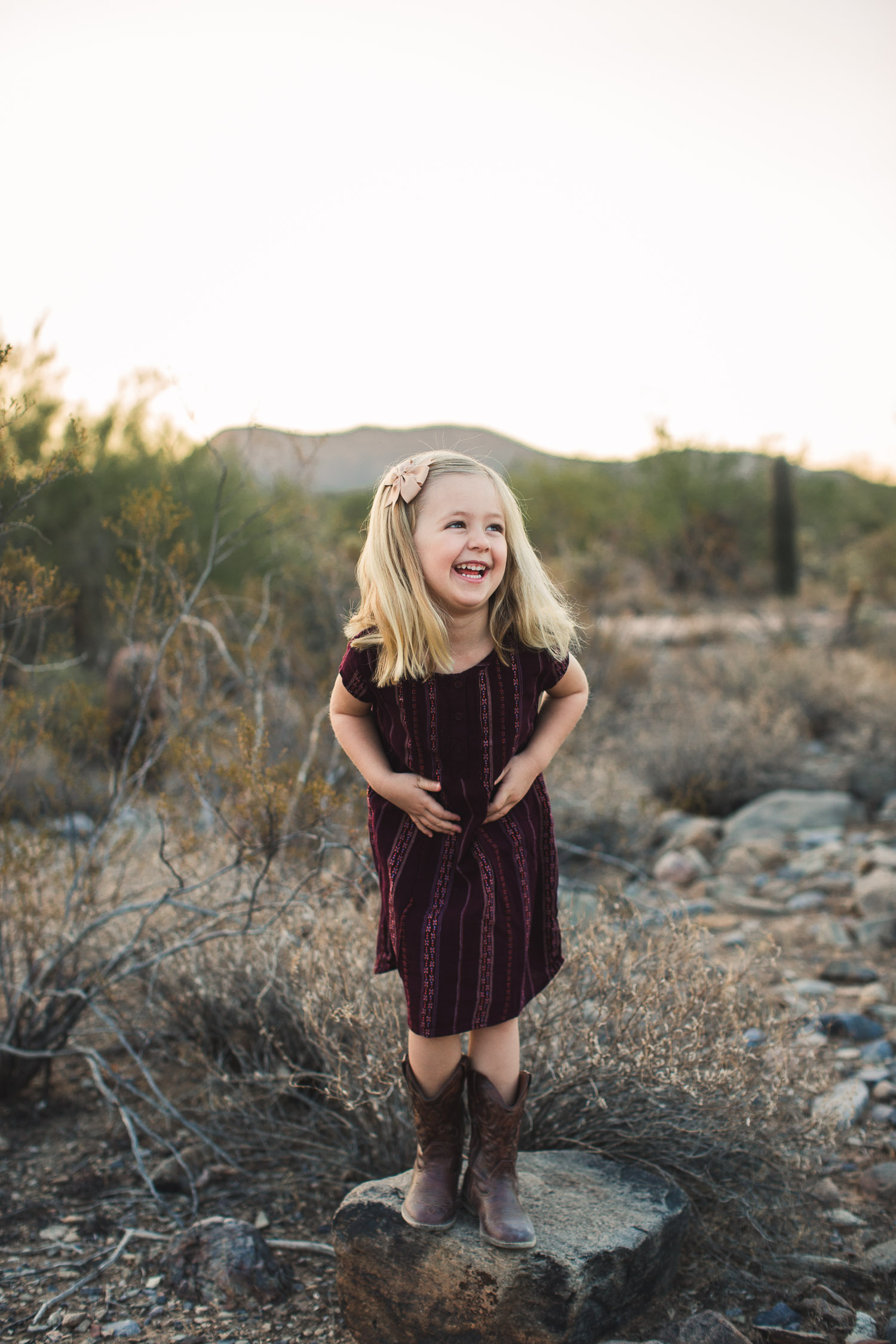 candid photo little girl laughing desert Arizona family photograph
