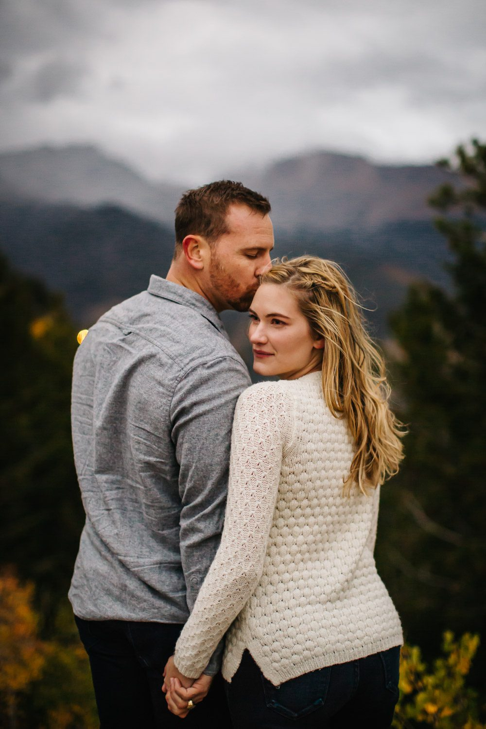 windy mountain engagement session Estes Park Colorado
