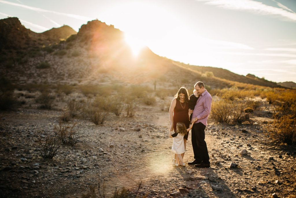 golden sunlight desert mountain candid family photography session