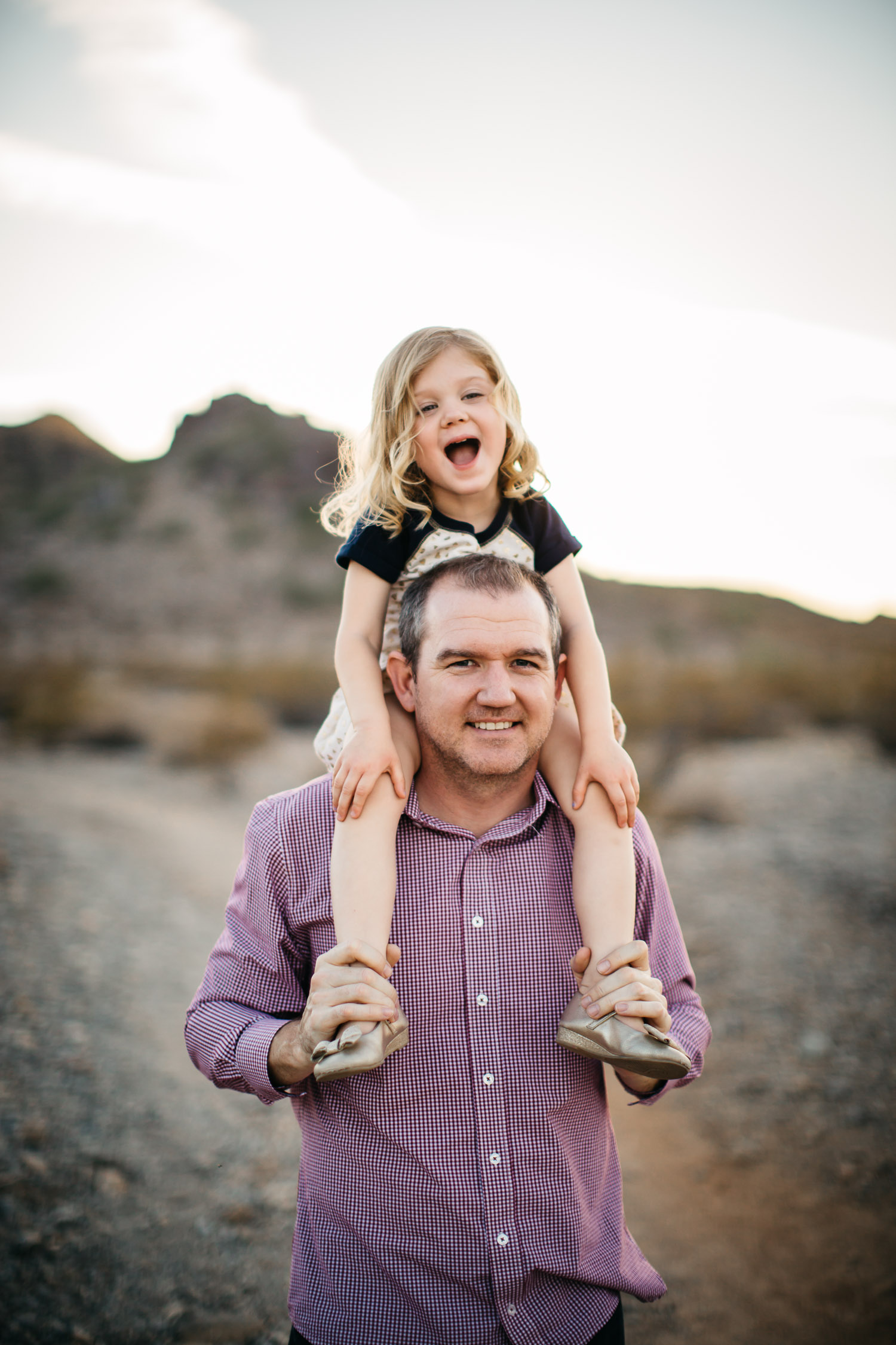 father daughter laughing candid fun family photograph