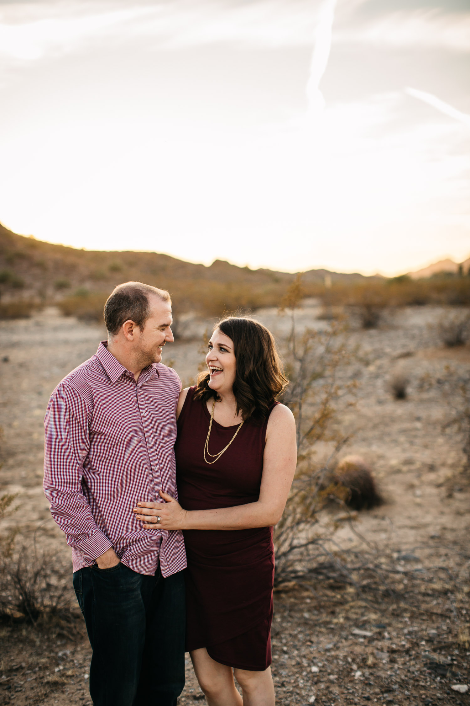 husband and wife mom and dad laughing sunset Arizona desert photo