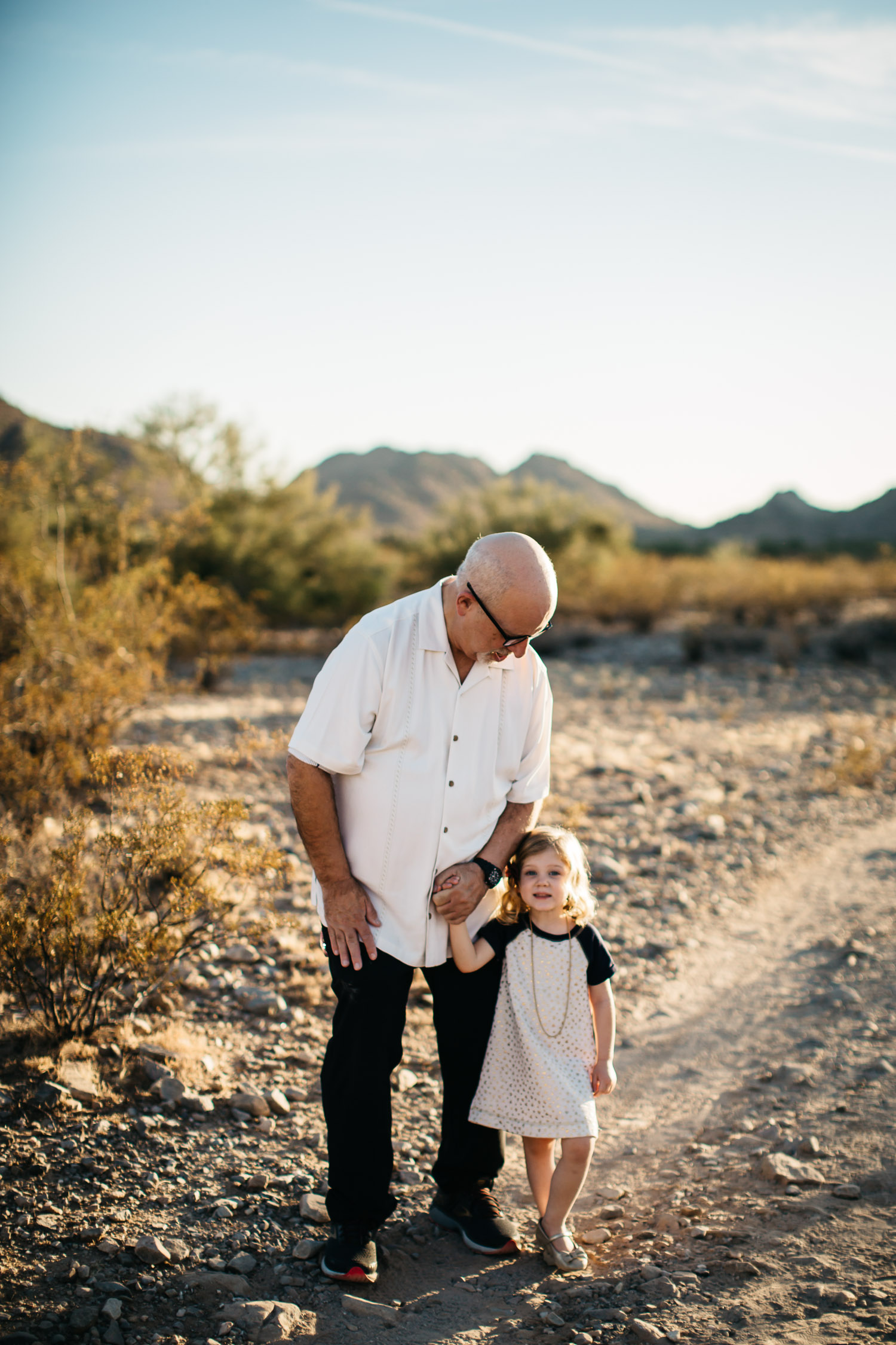 grandfather and little girl smiling holding hands Phoenix mountain preserve