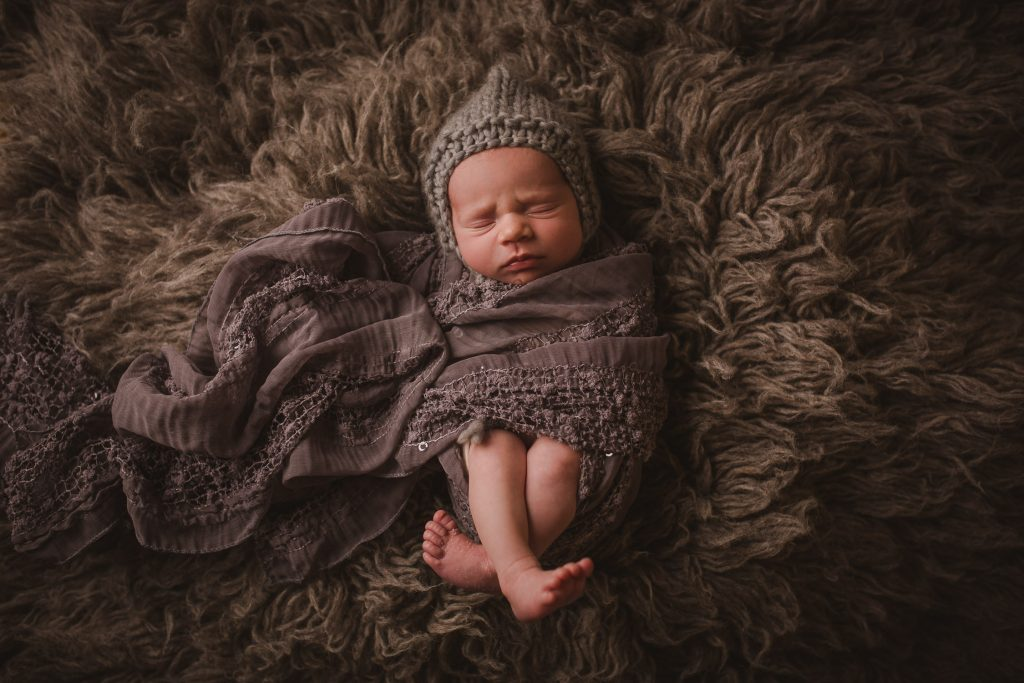 newborn baby boy shag rug wrapped sleeping beautiful studio lighting