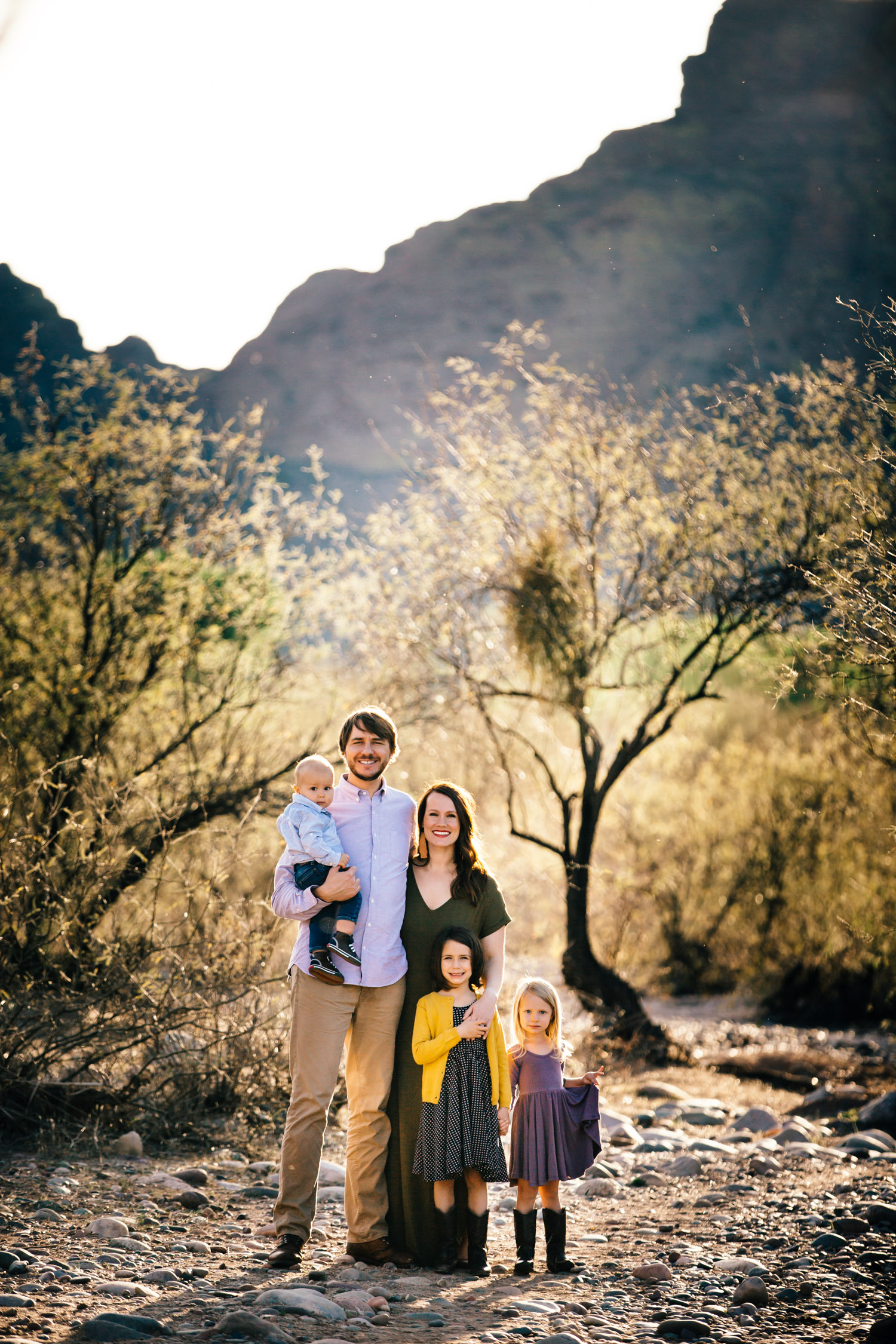 Young family photos sunshine mountains bold colorful Arizona