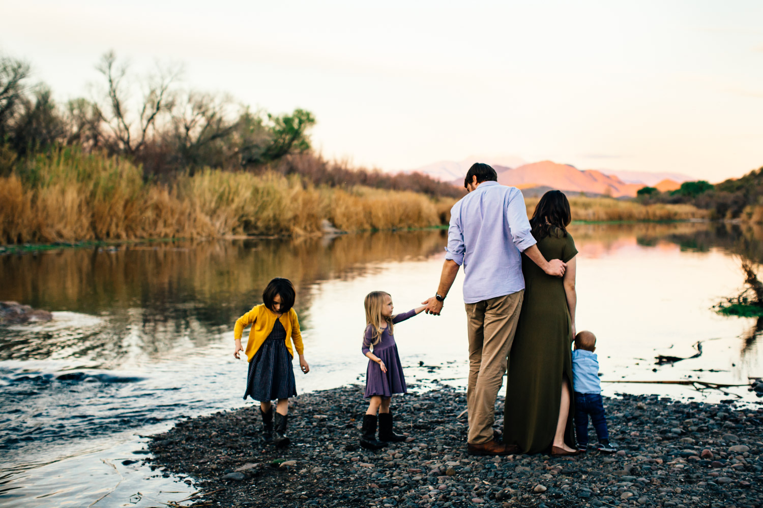 family playing by water at sunset Arizona colorful creative portrait photos